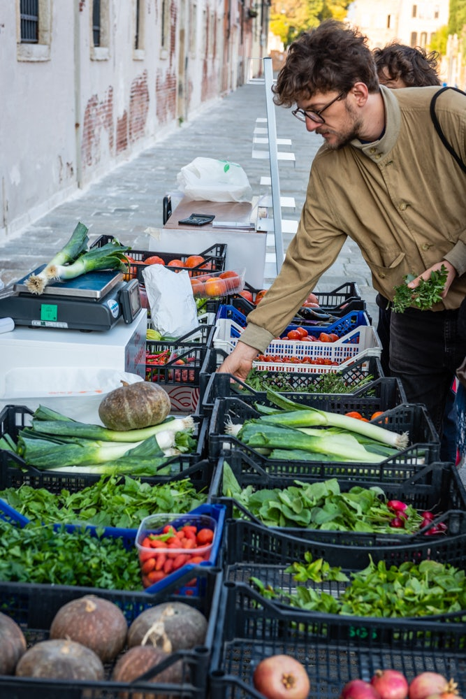 a man shopping for vegetables at the Orto delle Meraviglie