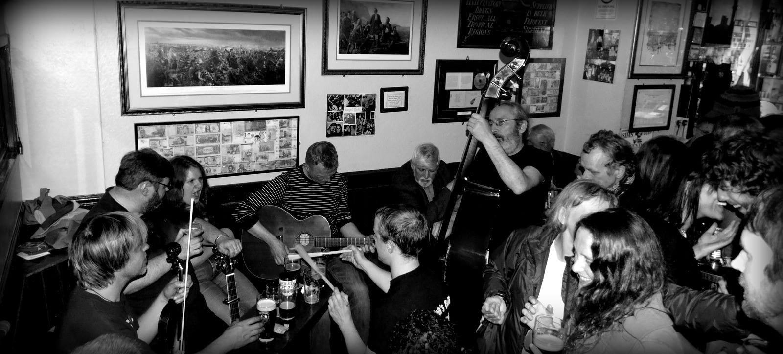 black and white picture of a folk band at The Royal Oak