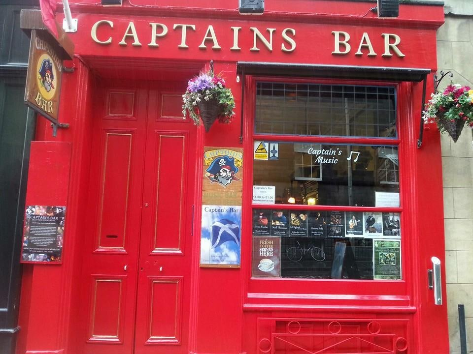 total red façade of the Captain's bar in Edinburgh