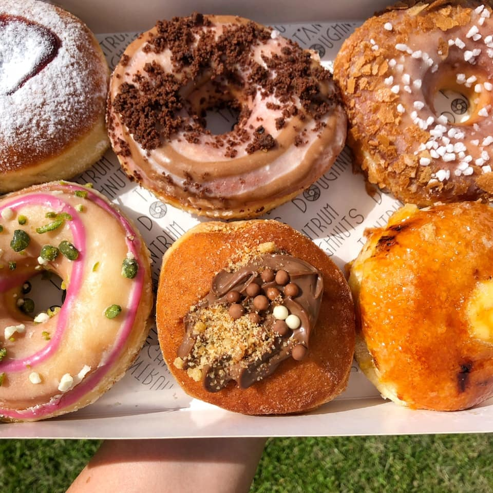a box of frosted doughnuts from Tantrum in Glasgow