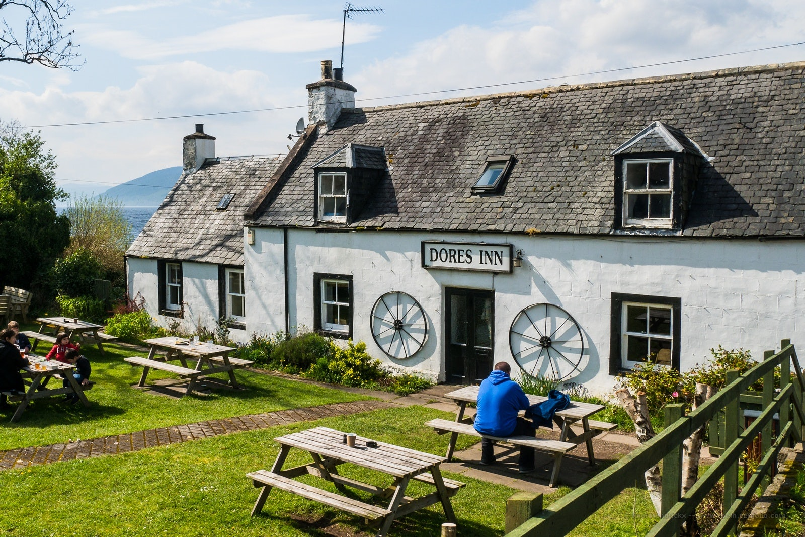 white exterior of Dores Inn cottage in Scotland