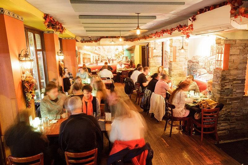 people eating at Yuca Bar NY