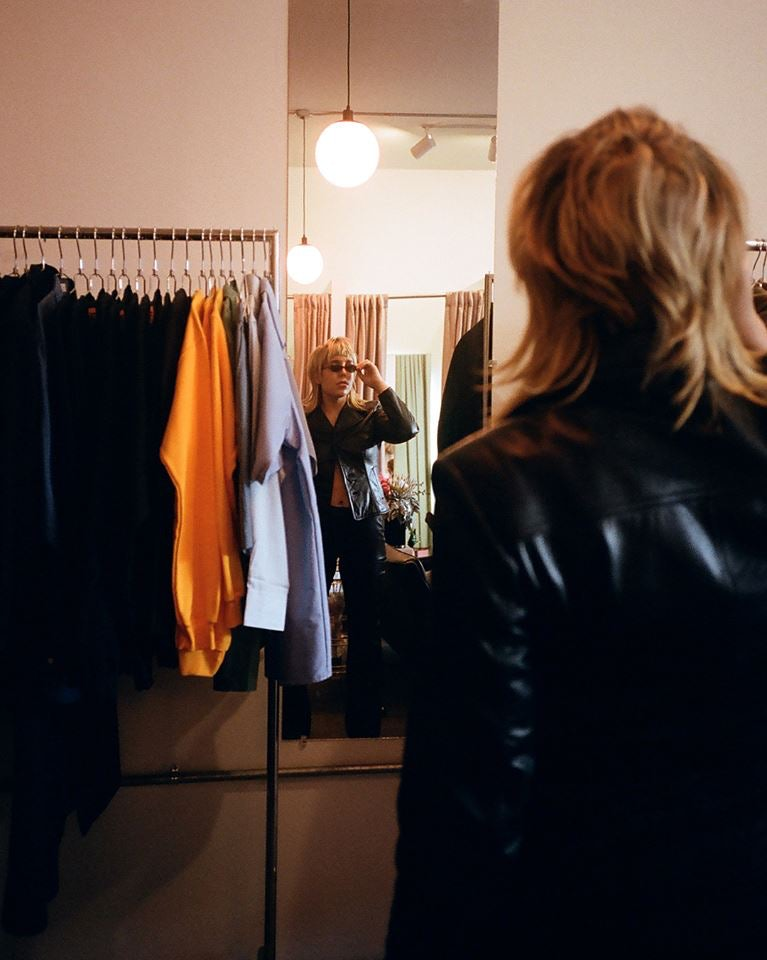 a woman fitting clothes at the Break NY