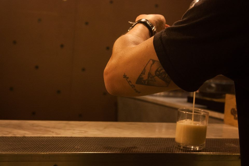 bartender making a cocktail at Il Baretto