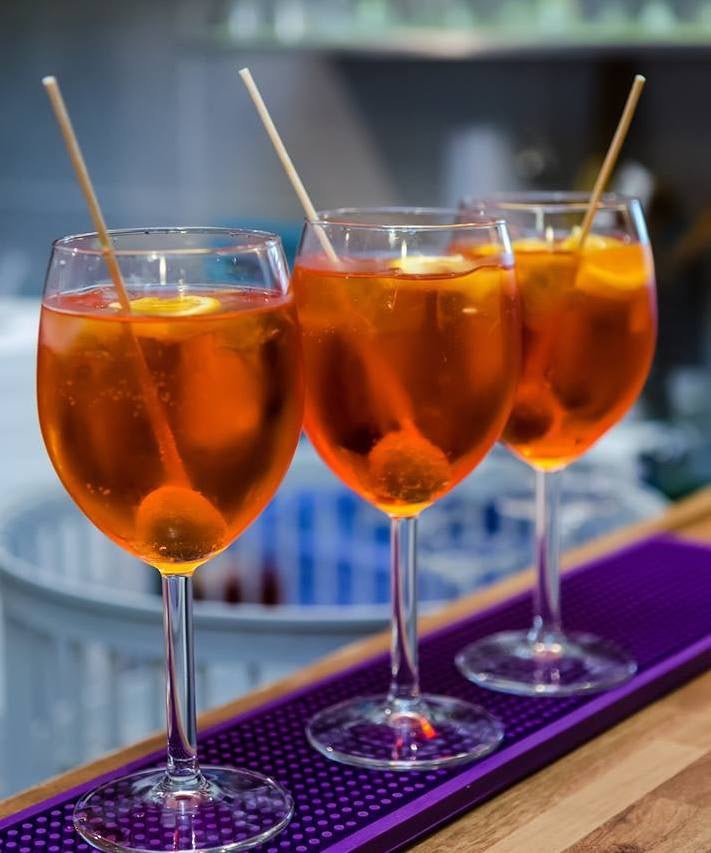 three aperol spritz at L'Ombralonga
