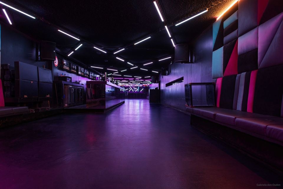 purple interior and lights at club Toffler