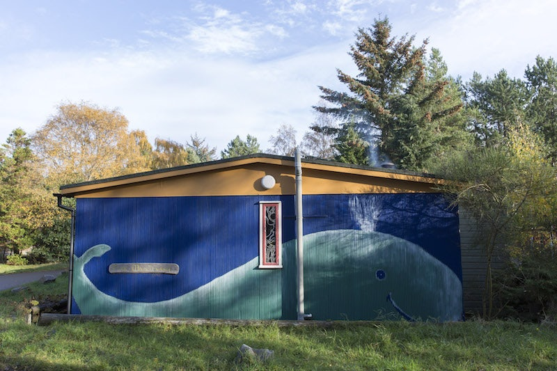 painting of a whale on a shed at the Findhorn Foundation