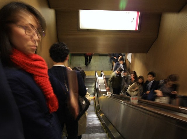 people on an escalator in Tokyo