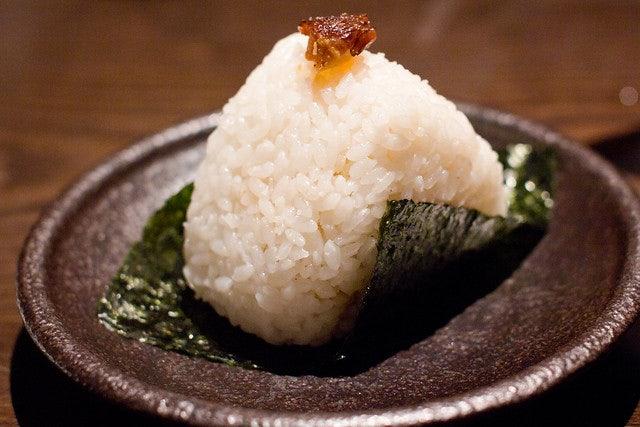 a piece of Onigiri on a plate