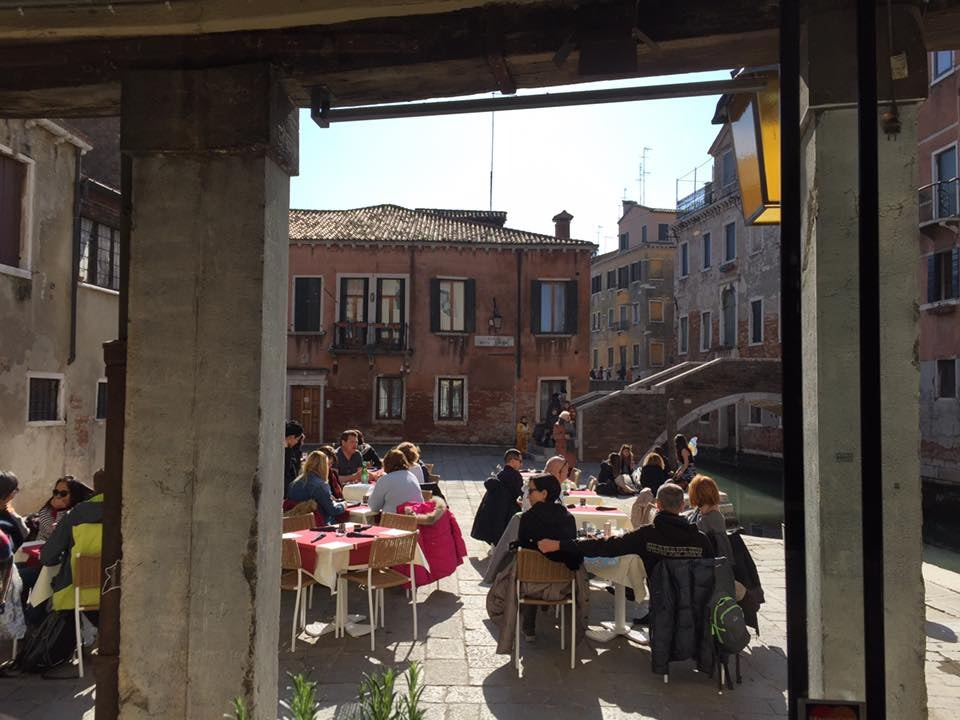 people dining at the terrace of Il Revolo Venice