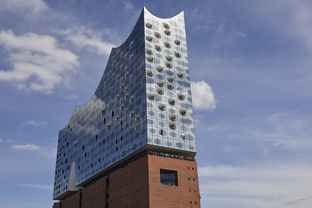 exterior of the Elbphilharmonie against a bright blue sky