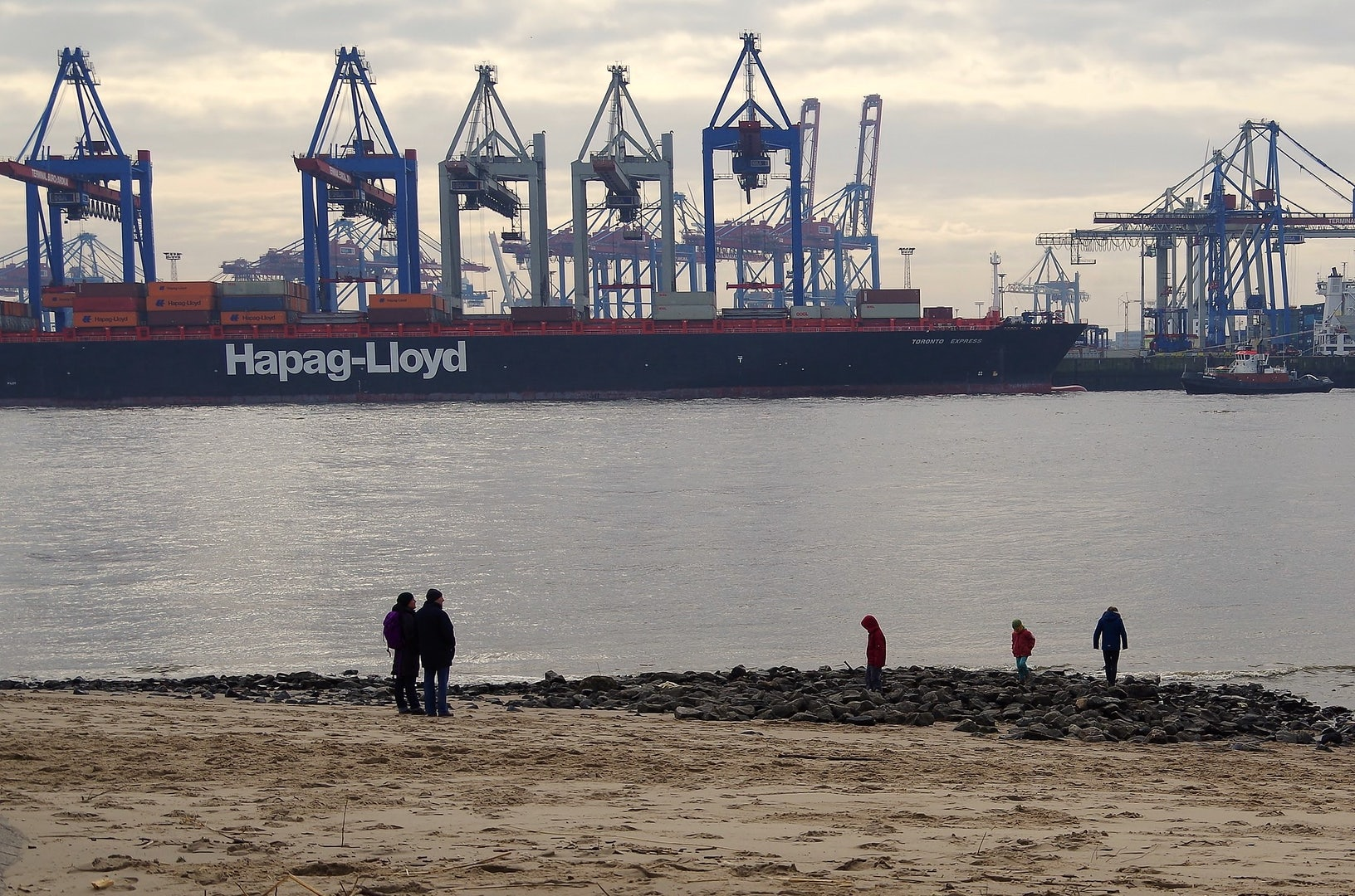 people and kids on the beach at the port of Oevelgönne in Hamburg