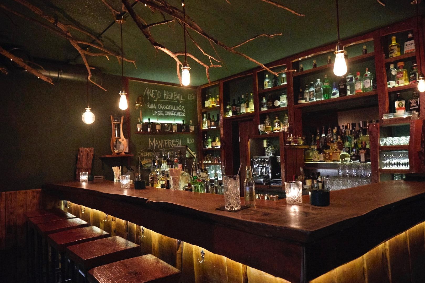 dark and wooden bar interior of Clockers Hamburg