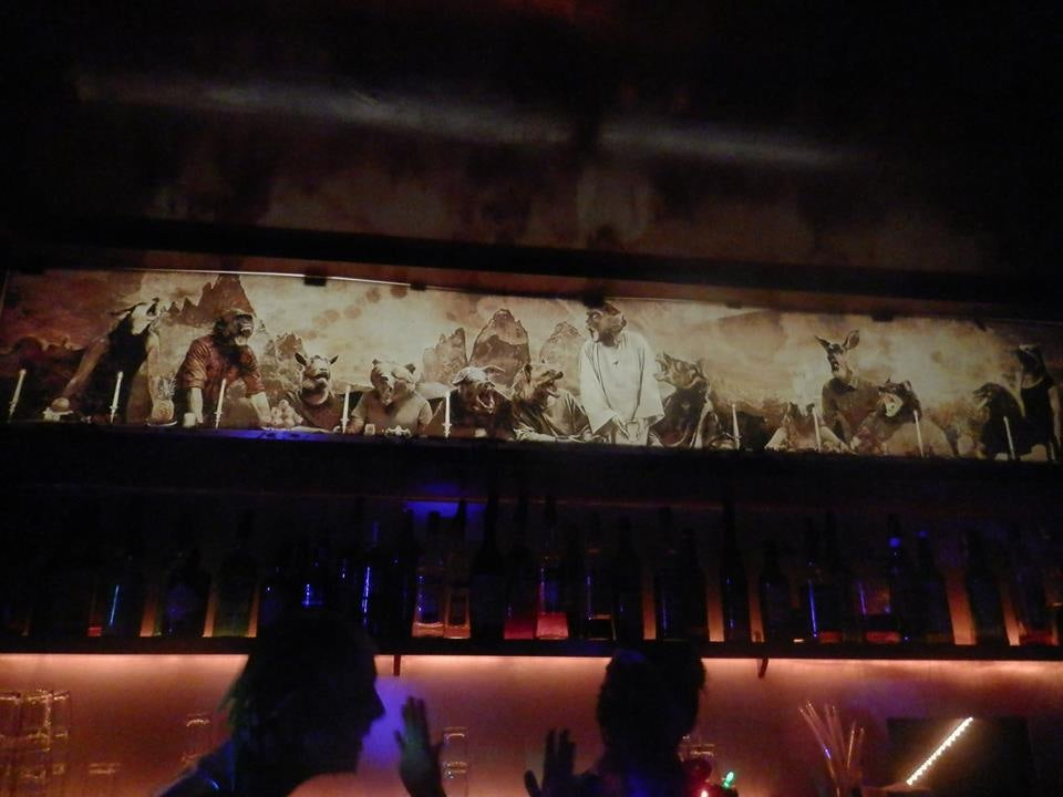 dark interior and wall decoration with animals at Thier bar