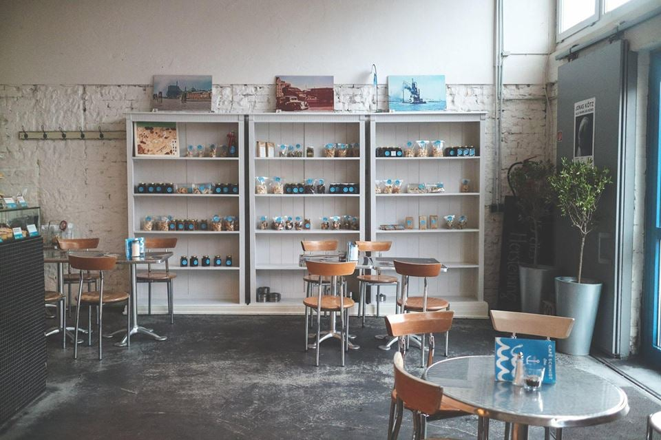 shelf with products and interior of brunch bar Café Schmidt Elbe