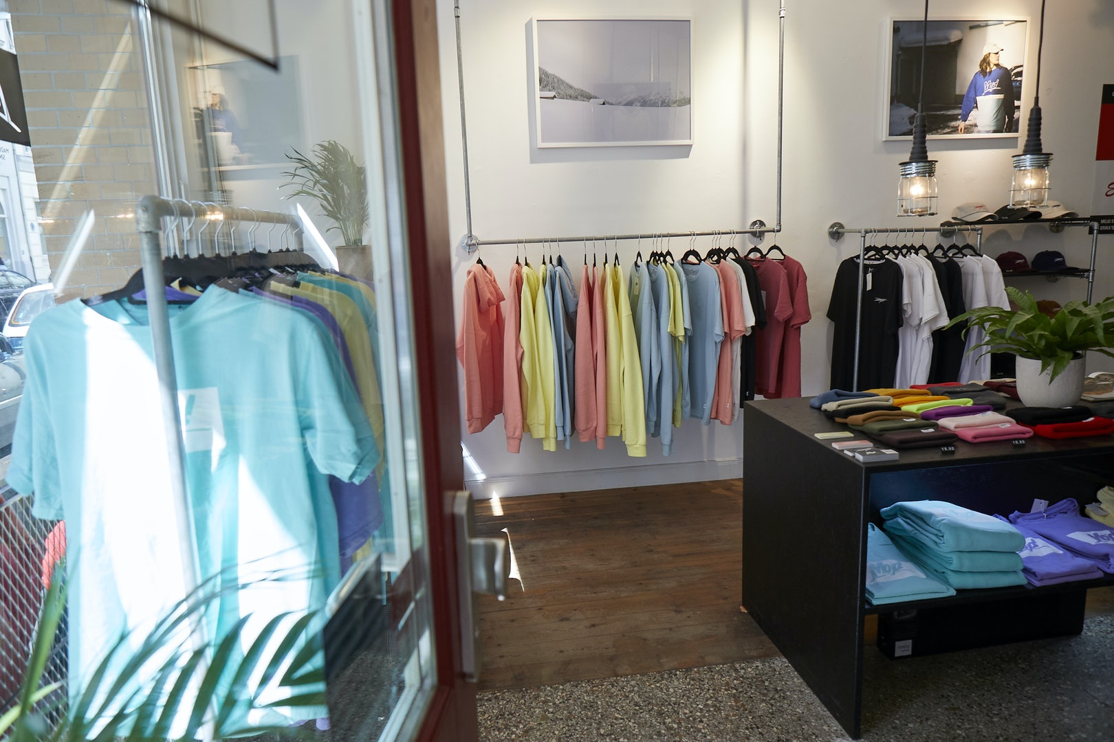 store interior and colourful mens' tshirts at Mojo store in Hamburg