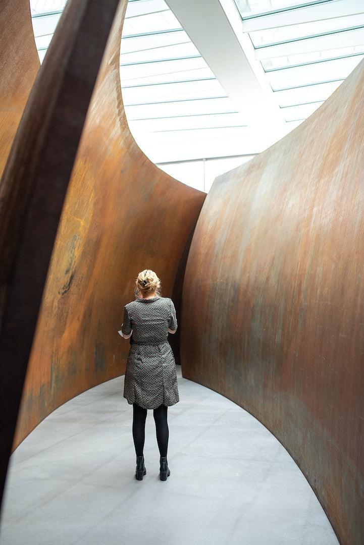 a woman admiring art at Museum Voorlinden in The Hague