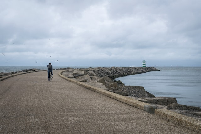 a man cycling on the Pier Head in Scheveningen