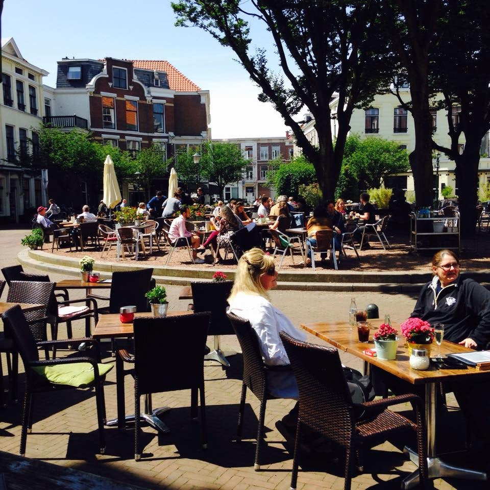 people on the terrace of Room restaurant in The Hague