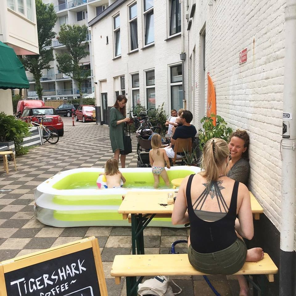 people and children outside Tigershark coffee bar in the Hague