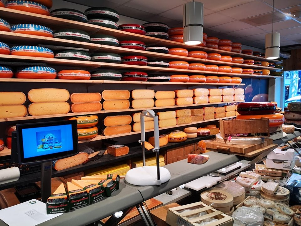 a wall full of cheese rolls at Kalkman store in The Hague