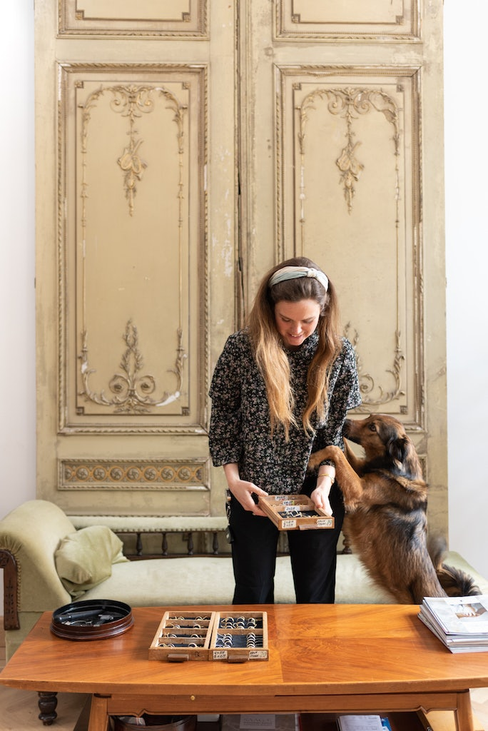Liesbeth Busman with her dog at her jewellery shop in The Hague