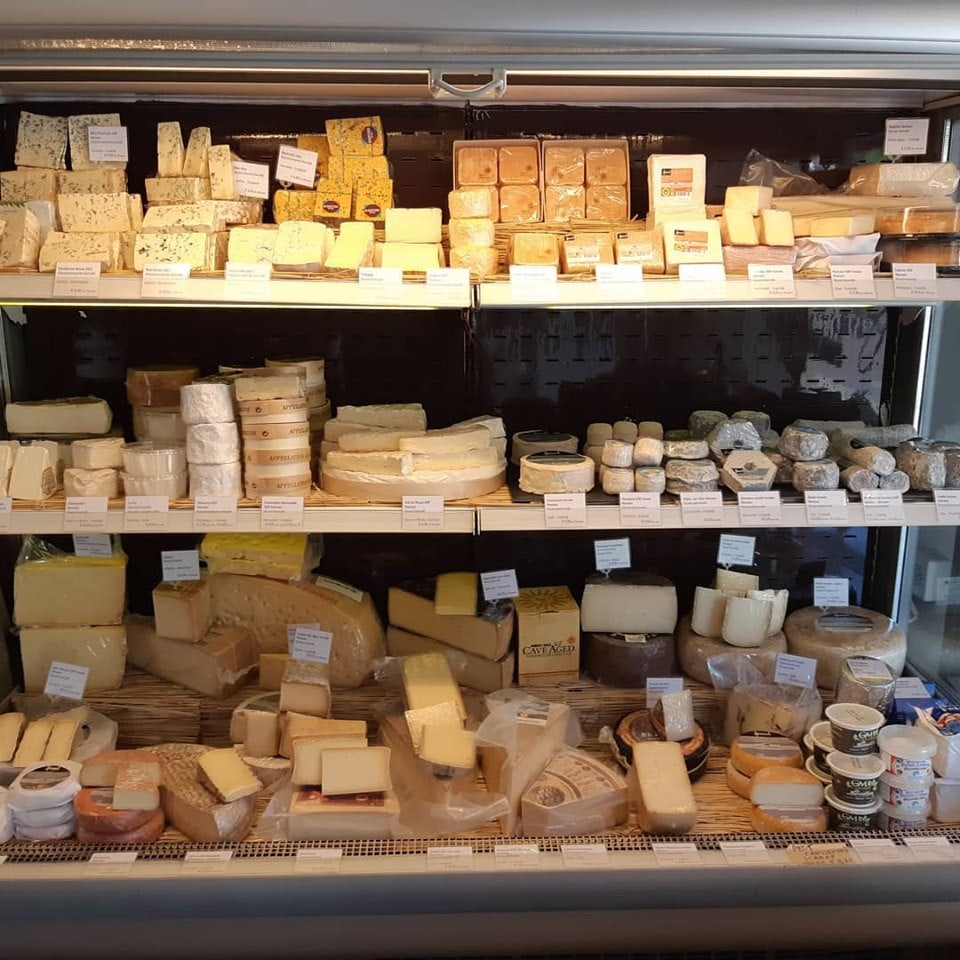 Fridge with different kinds of cheese at Proefhuys store in The Hague