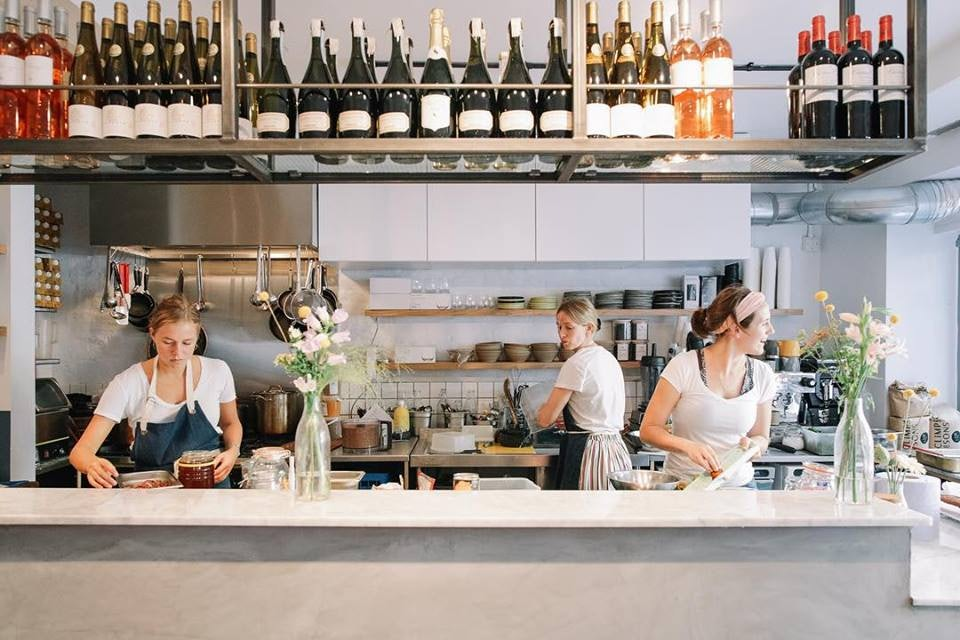 staff cooking at 26 Grains restaurant