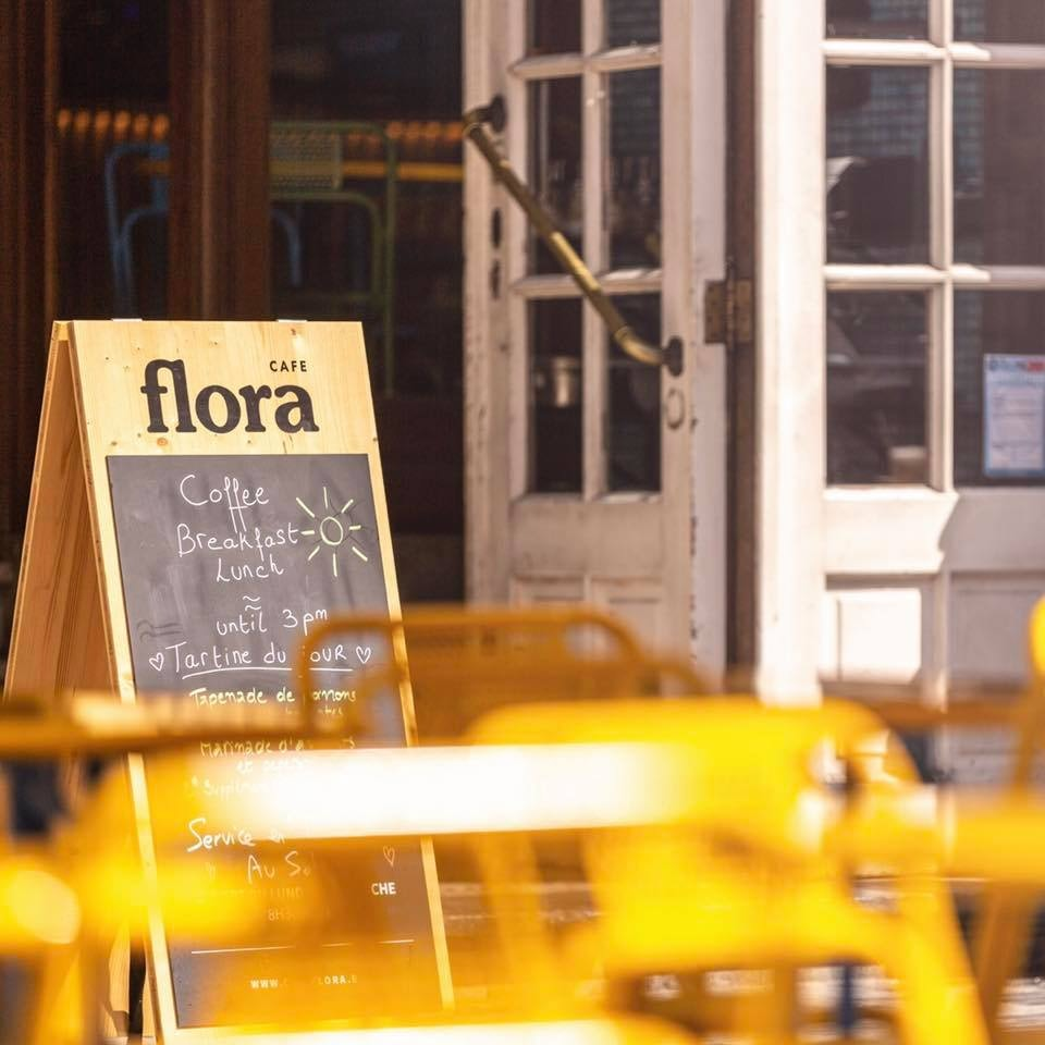 terrace and street sign of Cafe Flora Brussels