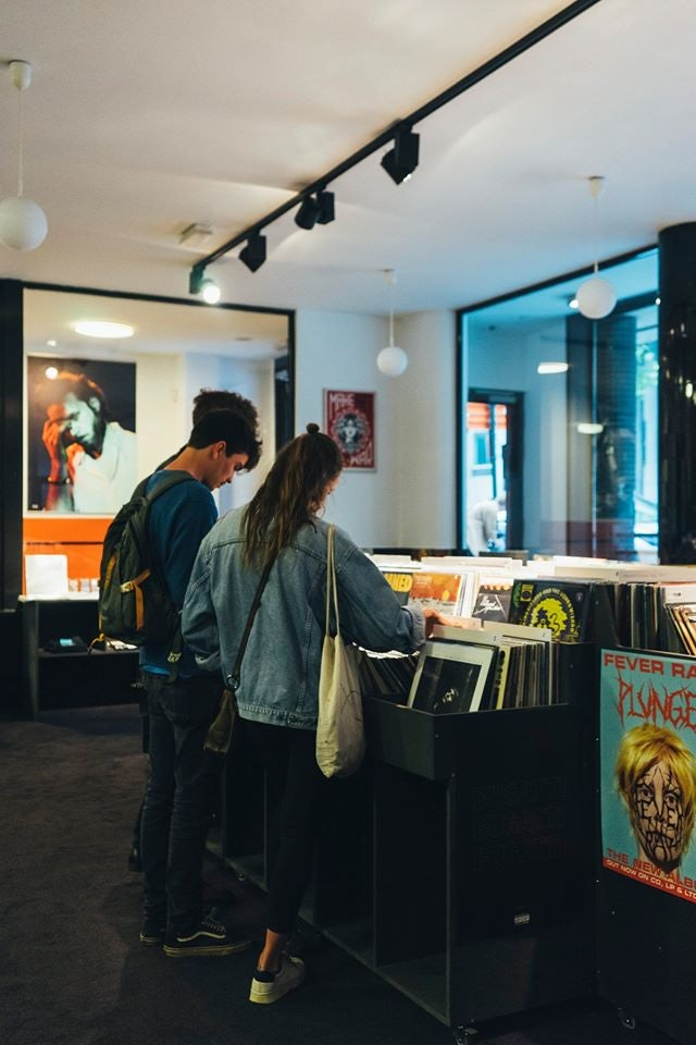 man and woman in record store Chez Pias in Brussels