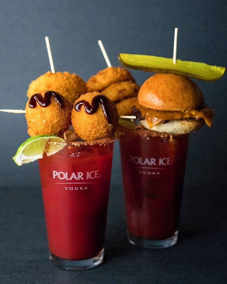 two caesars from Score on Davie with snacks on top