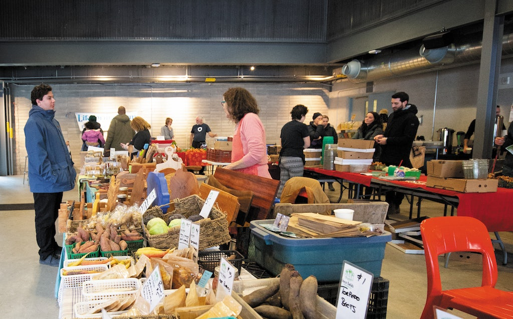 people buying groceries at the Evergreen Brick Work's farmer market