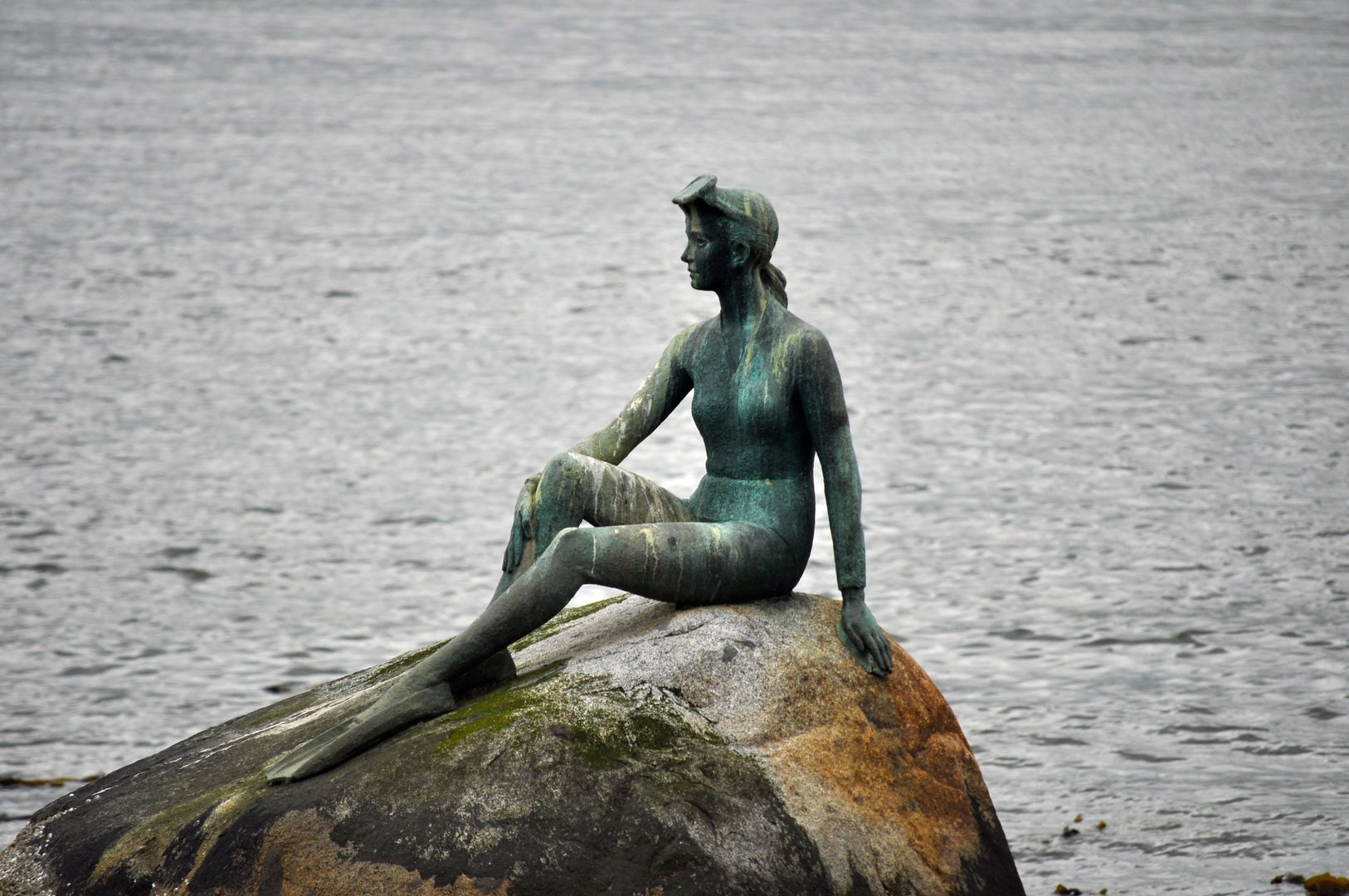 statue by the Vancouver seawall 'Girl in a Wetsuit'
