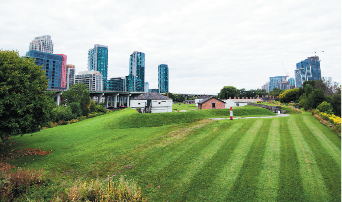 lawn of the Fort York against skyscrapers in Toronto