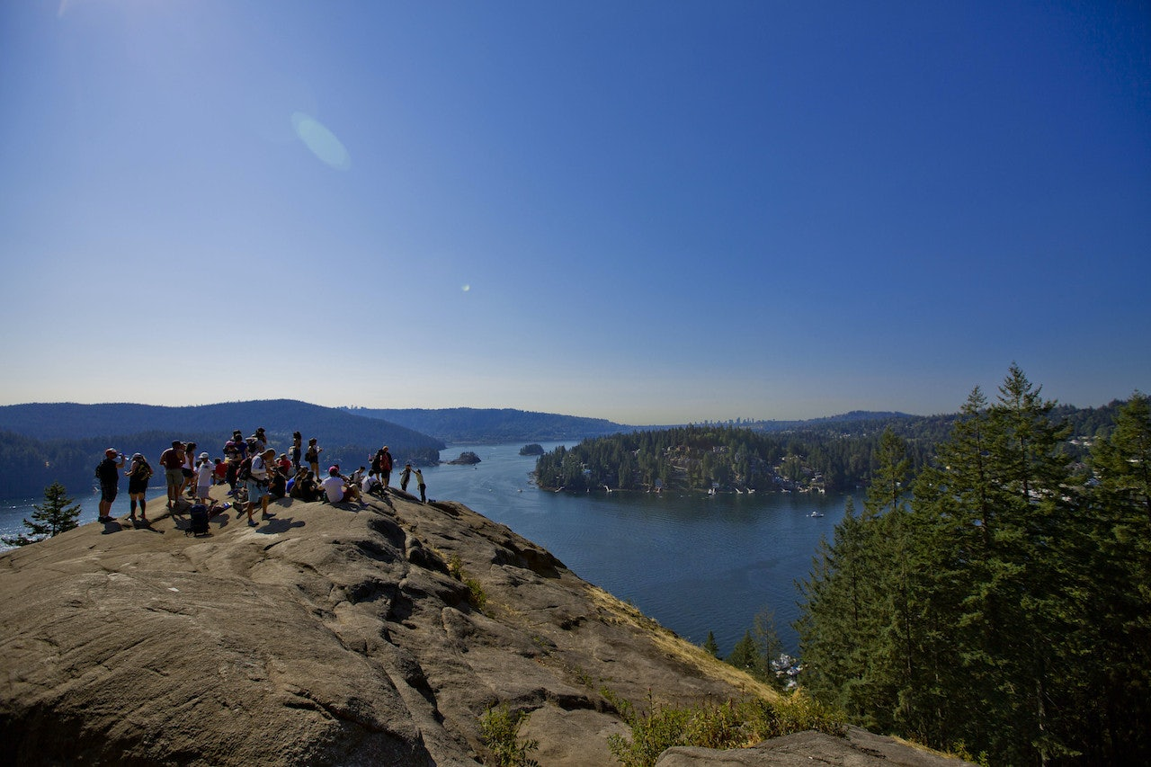 a group of hikers on top of Quarry Rock