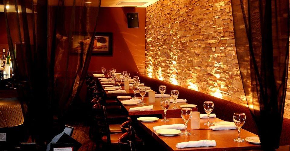 dimly lit restaurant interior of AlleyCatz in Toronto