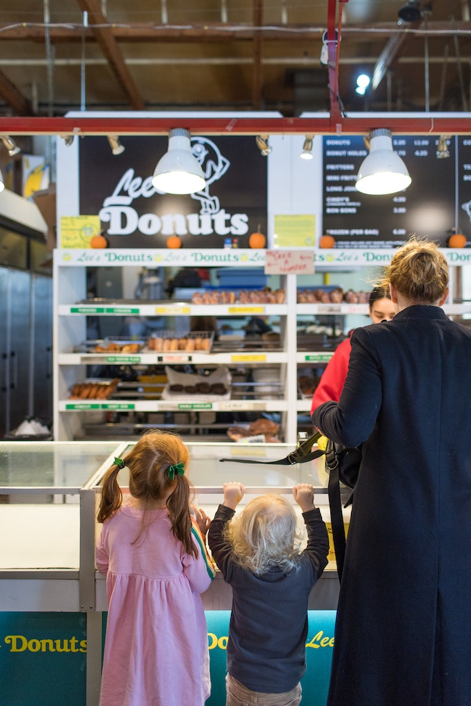 kids and mother ordering donut at Lees Donuts in Granville Island Market