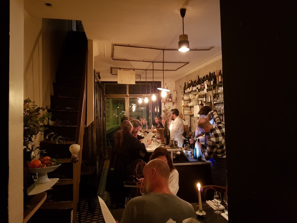 people having a drink at wine bar Vivant Paris