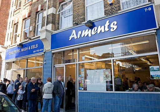 people queueing at Arments Pie and Mash shop