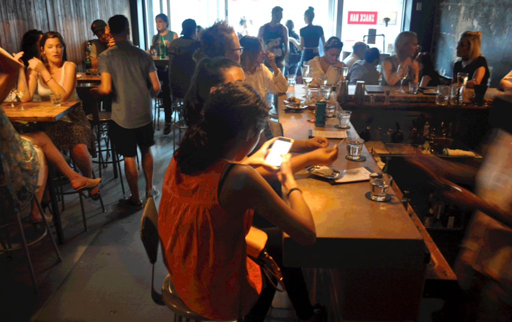 people enjoying a drink at snackbar 416 Toronto