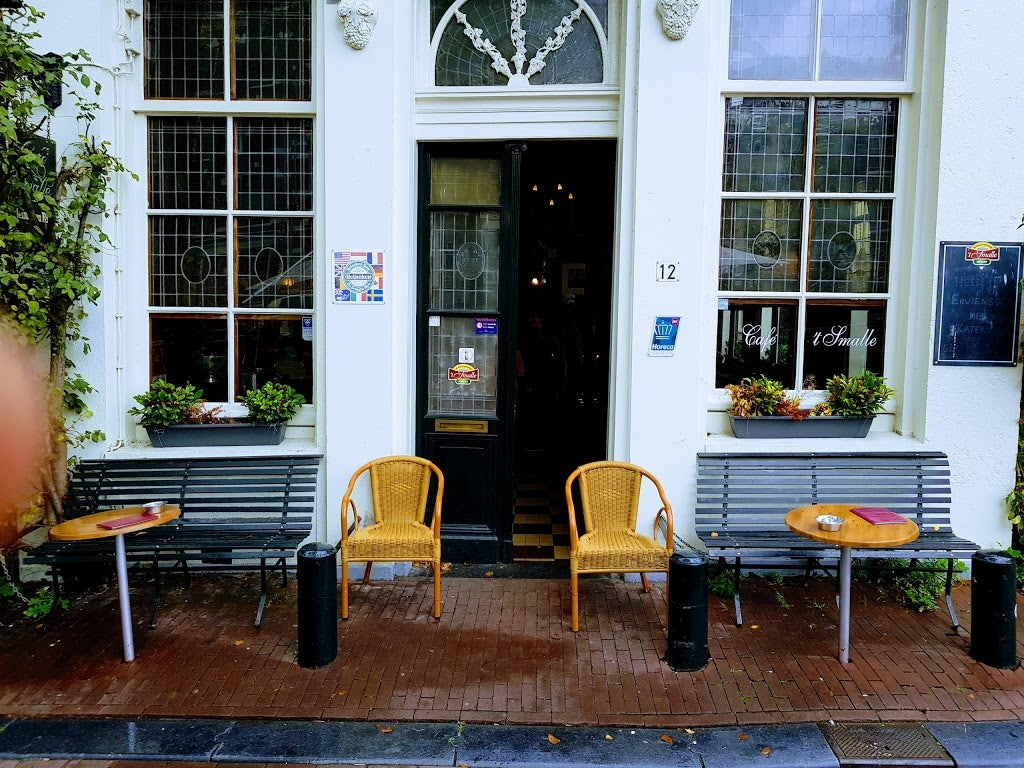 facade and tables outside of Cafe t Smalle in Amsterdam