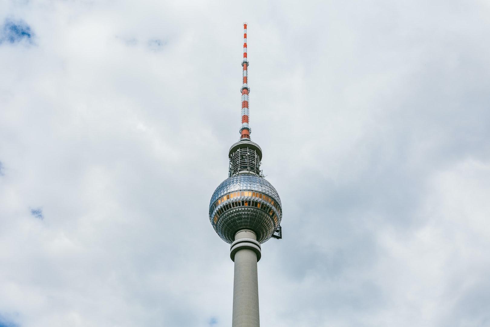 berlin fernsehturm against a blue cloudy sky