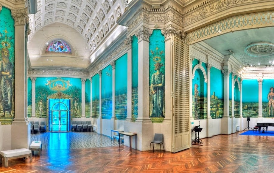 vivid blue-green interior with wall paintings at the fondation Carzou