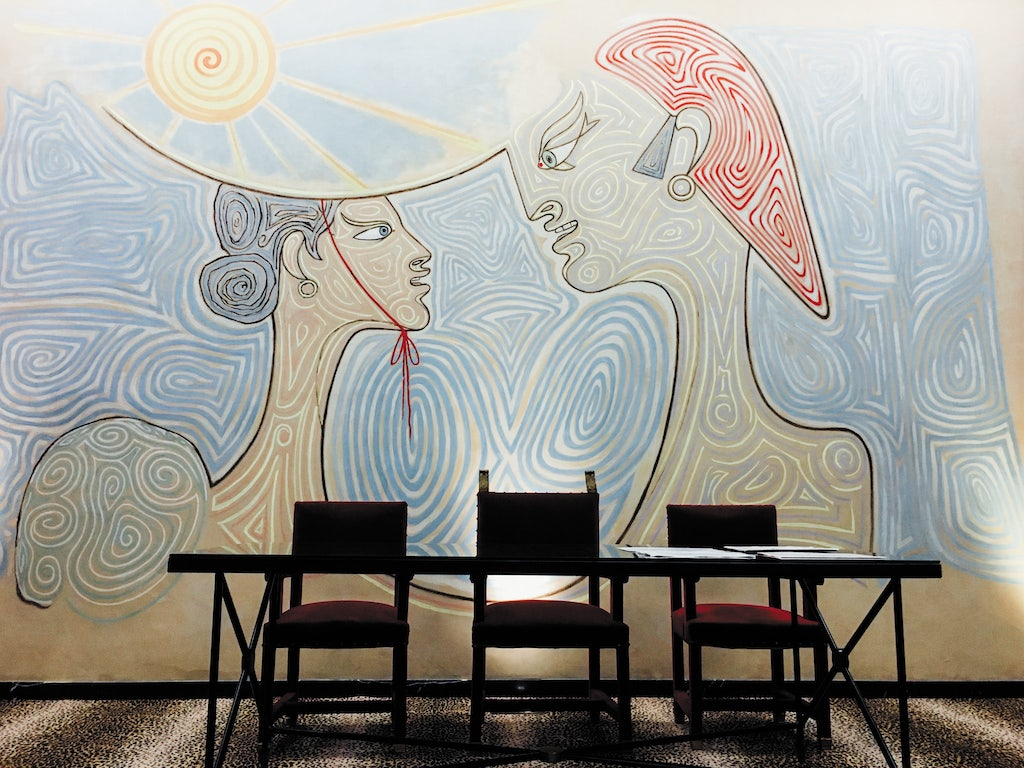 a painting on the wall of a couple by Jean Cocteau at the Hotel de Ville Menton