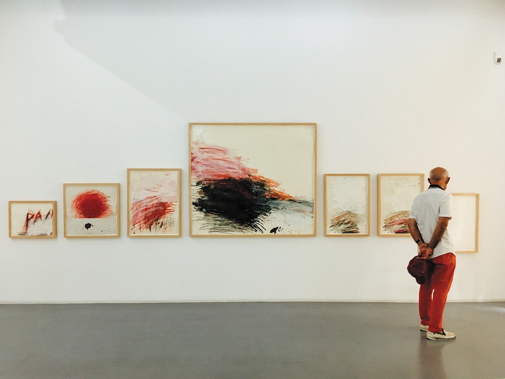 a man dressed in red pants is admiring art at the Collection Lambert
