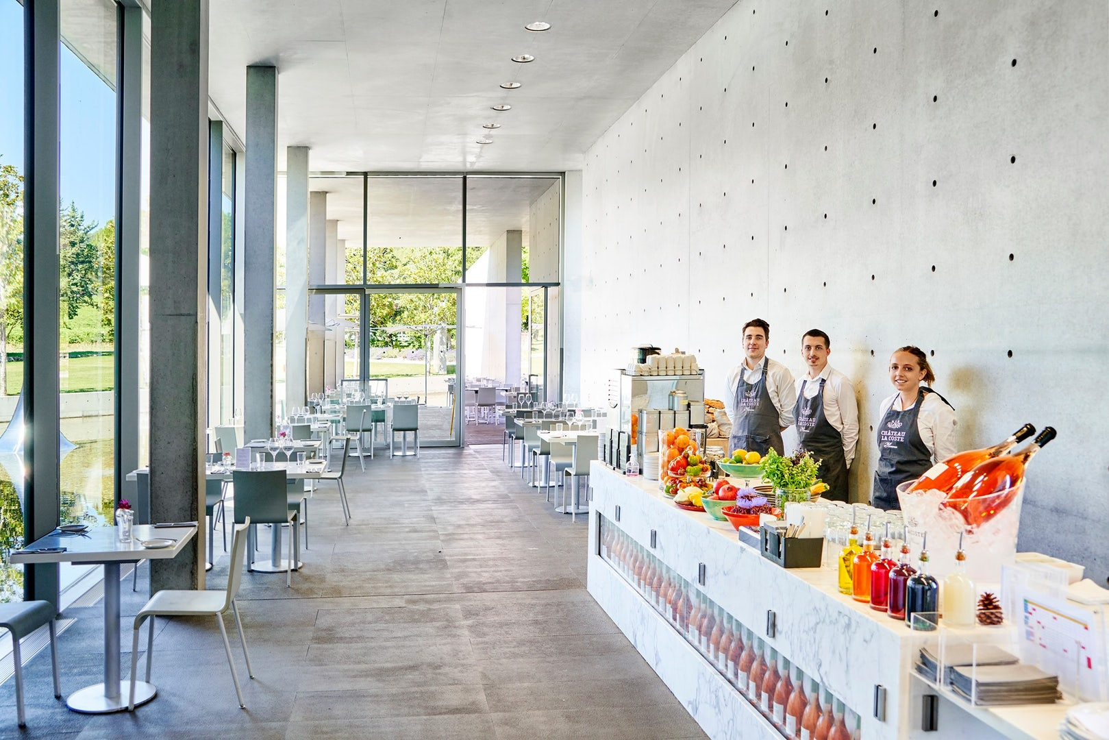 minimalist restaurant interior and the staff at the Château La Coste