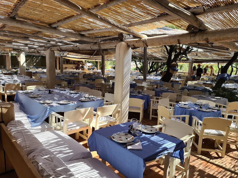 cozy outdoor area at Le Club 55 restaurant