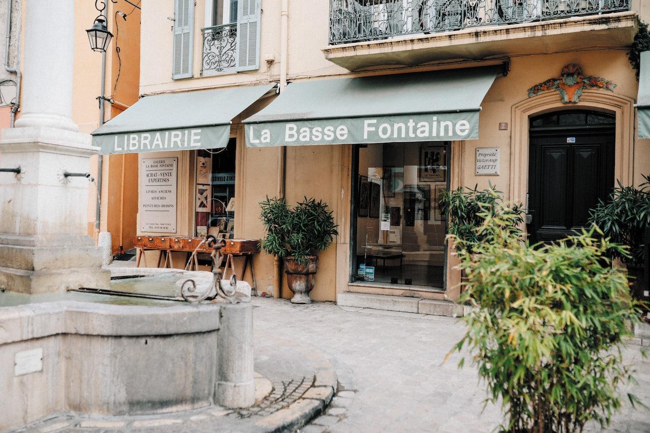 the pastel-orange front of La Basse Fontaine bookshop