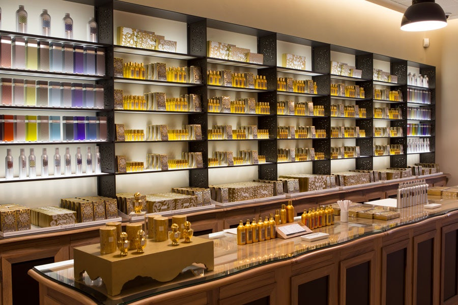 shop interior with a wall full of perfume bottles at Perfumerie Fregonard