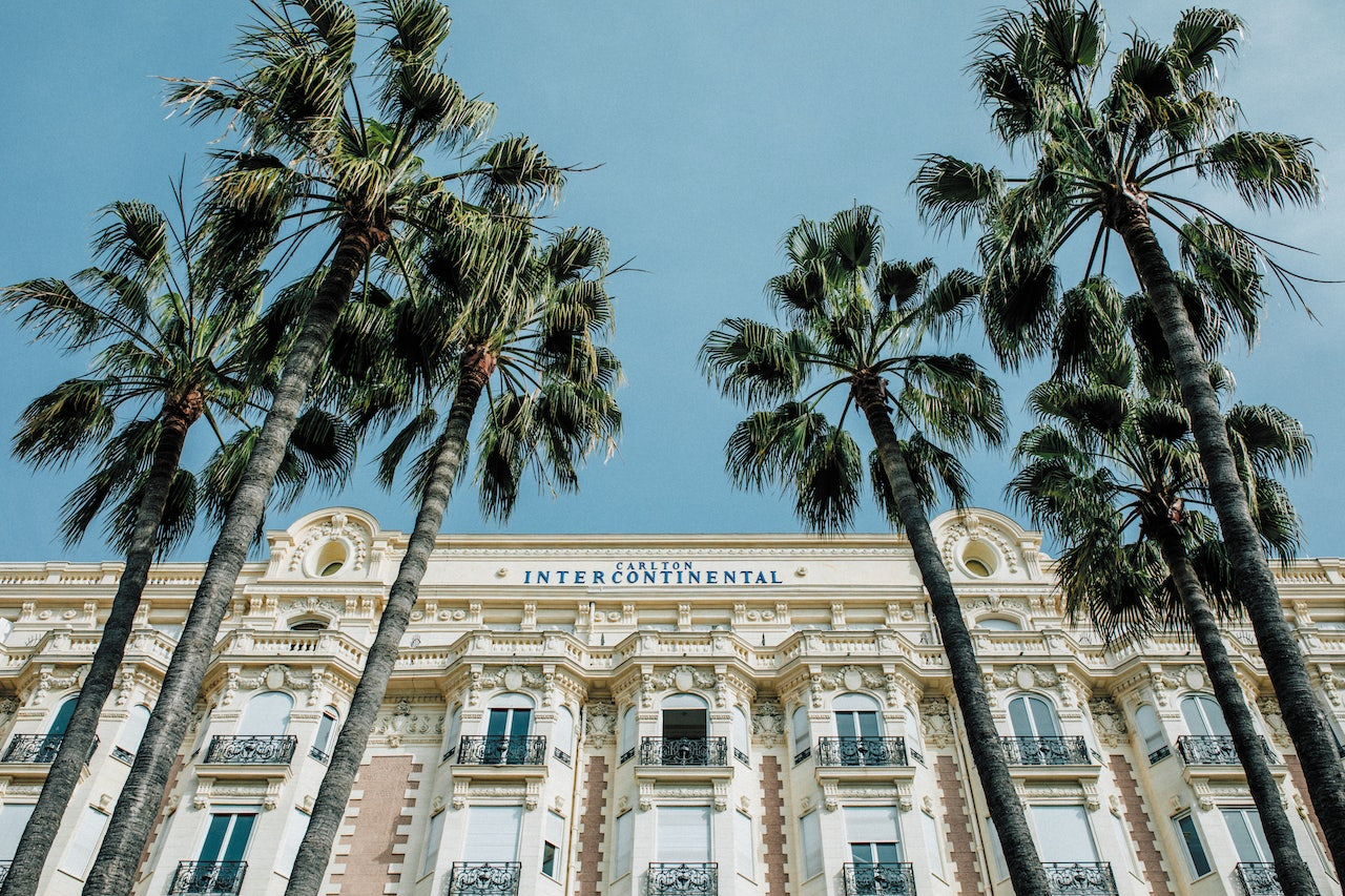 building facade and palmtrees at the Carlton Hotel in Cannes